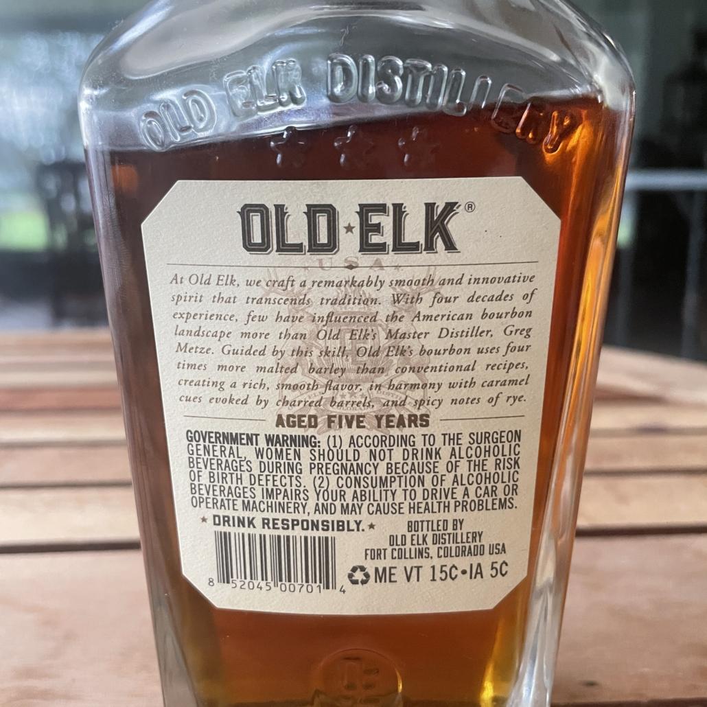 The Back Label of a bottle of Old Elk Blended Straight Bourbon Whiskey