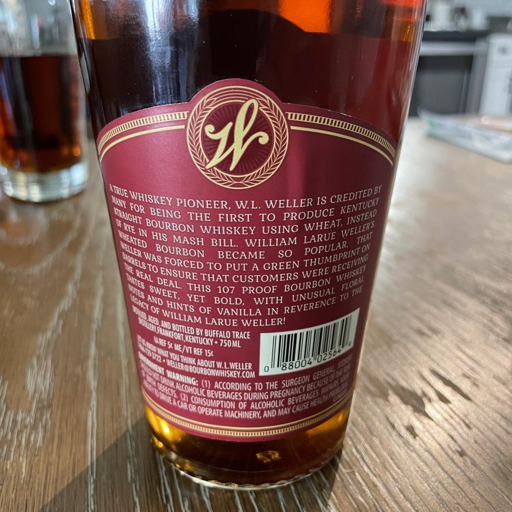 The back label of a bottle of weller antique 107 bourbon whiskey